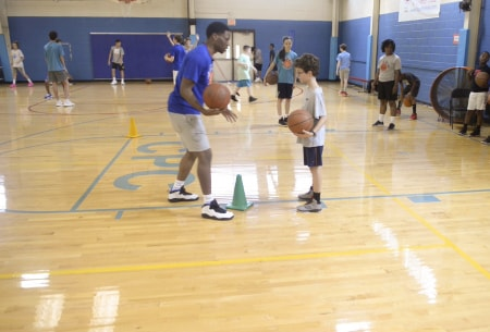 trainer coaching a young boy